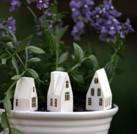 miniature wooden houses by Lauren Gray