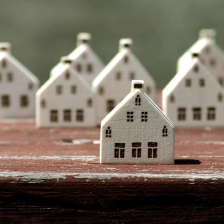 miniature wooden houses by Lauren Gray