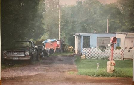 Trailer House with Mailbox by John Salt