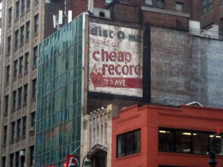Disc-o-mat Ghost Sign in NYC