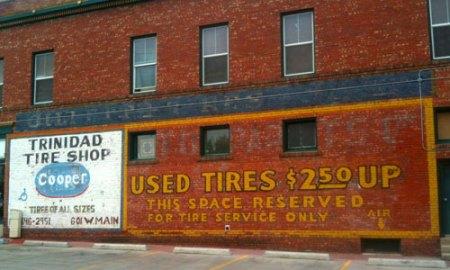 Trinidad Tire Shop Ghost Sign in Trinidad, CO