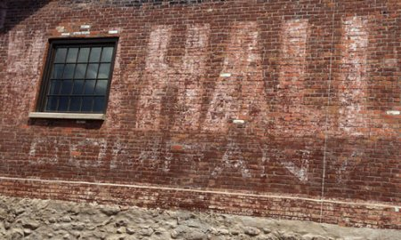 Wm. Hall Sells Everything Ghost Sign in Gardiner, MT