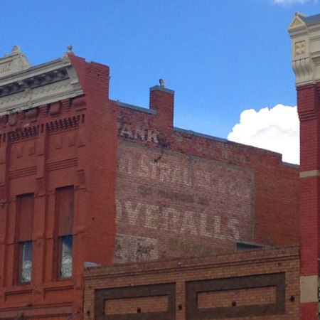 Overalls Ghost Sign in Livingston, MT