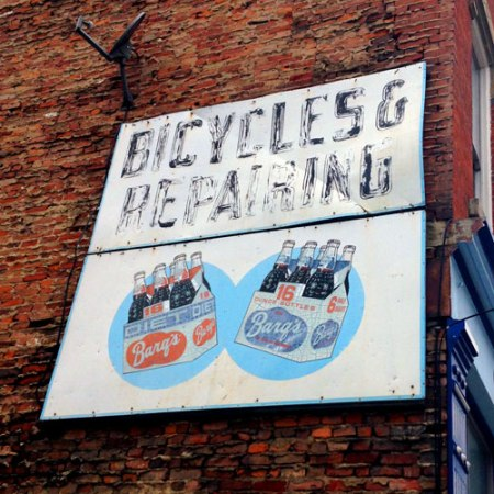 Barq's/Bicycles & Repairing Ghost Signs in Over-the-Rhine